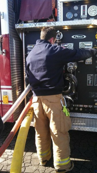 Firefighter DeLallo is pumping one of our engines--this is one of the many important duties that occur on a fire scene.