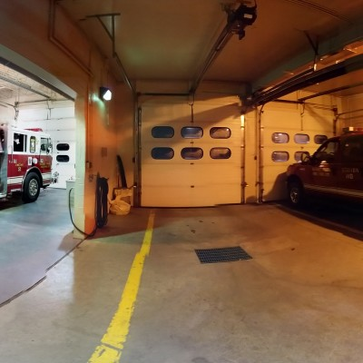 This is the Milford Station apparatus bay. The radio room is the man door you see on the far right--the apparatus housed here, from right to left, are 110-Squad 2 and 110-Engine 2.