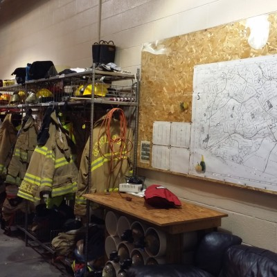 Milford Station responders hang their gear rack on the driver's side of 110-Engine 2. This part of the station is also where a street map of the community is hung for reference when responding to a call.